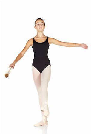 Young caucasian ballerina girl on white background and reflective white floor showing various ballet steps and positions. Battement Fondu. Not Isolated. Stock Photo - Budget Royalty-Free & Subscription, Code: 400-05122342