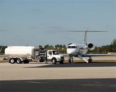Modern business jet on a tarmac for fueling Stock Photo - Budget Royalty-Free & Subscription, Code: 400-05122399
