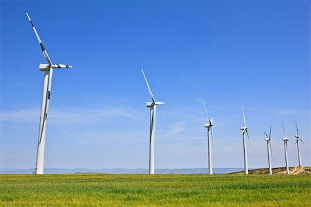 Wind turbines farm in green field over cloudy sky Stock Photo - Budget Royalty-Free & Subscription, Code: 400-05134654