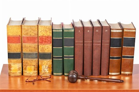 Wooden gavel from the court and old law books reflected on white background. Shallow depth of file Stock Photo - Budget Royalty-Free & Subscription, Code: 400-05134977