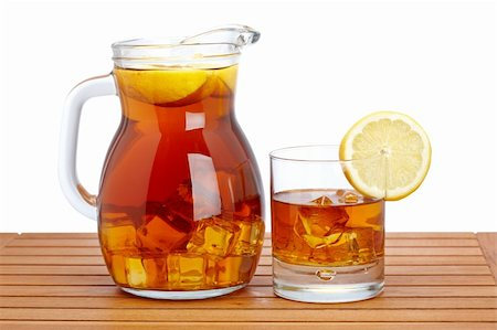 Ice tea pitcher and glasss with lemon and icecubes on wooden background. Shallow depth of field Stock Photo - Budget Royalty-Free & Subscription, Code: 400-05135234
