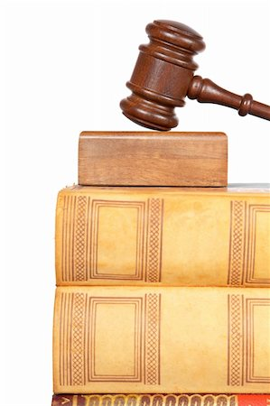 Wooden gavel from the court and law books isolated on white background. Shallow depth of field Stock Photo - Budget Royalty-Free & Subscription, Code: 400-05136441