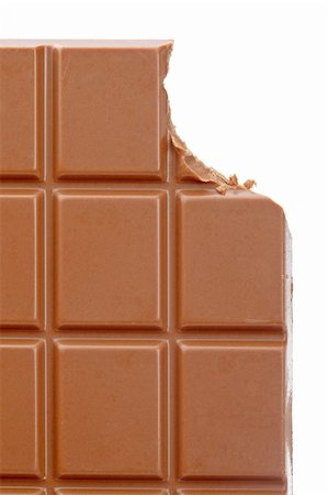 Bitten chocolate bar isolated on white background. Shallow depth of field Stock Photo - Budget Royalty-Free & Subscription, Code: 400-05136453