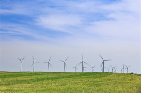 Wind turbines farm in green field over cloudy sky Stock Photo - Budget Royalty-Free & Subscription, Code: 400-05136468