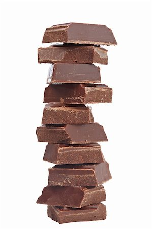 Blocks of chocolate isolated on white background. Shallow depth of field Stock Photo - Budget Royalty-Free & Subscription, Code: 400-05136813