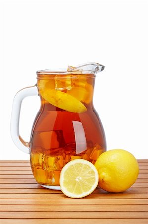Ice tea pitcher with lemon and icecubes on wooden background Stock Photo - Budget Royalty-Free & Subscription, Code: 400-05139352