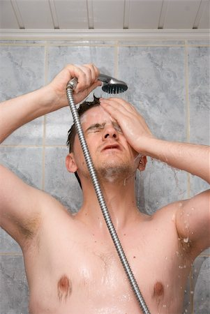 Man having shower in bathroom with soap and shampoo Stock Photo - Budget Royalty-Free & Subscription, Code: 400-05132694