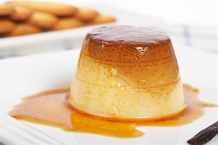 Vanilla cream caramel dessert and cookies on white dish. Shallow depth of field Stock Photo - Budget Royalty-Free & Subscription, Code: 400-05133909
