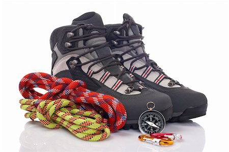 Hiking boots, two rope and compass reflected on white background Stock Photo - Budget Royalty-Free & Subscription, Code: 400-05133946