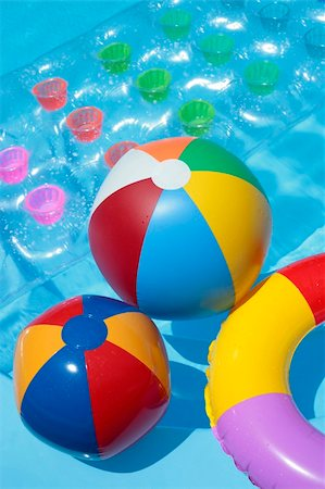 spanishalex (artist) - Beach balls, a rubber ring and a lilo in a nice blue pool Stock Photo - Budget Royalty-Free & Subscription, Code: 400-05146459