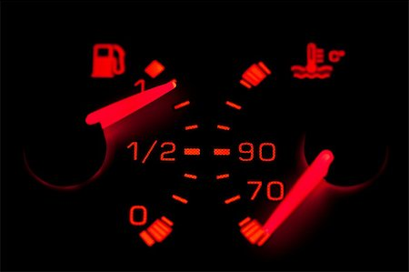 Car dashboard gauges illuminated over a black background. Shallow depth of field Stock Photo - Budget Royalty-Free & Subscription, Code: 400-05146494