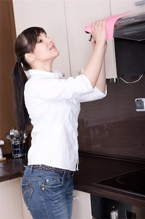 young brunette woman cleaning kitchen Stock Photo - Budget Royalty-Free & Subscription, Code: 400-05148025