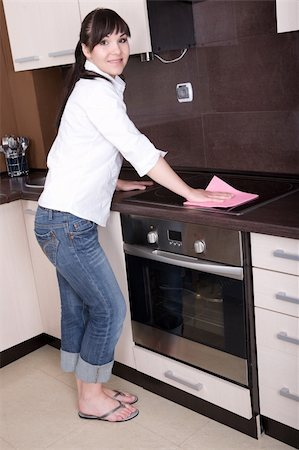 young brunette woman cleaning kitchen Stock Photo - Budget Royalty-Free & Subscription, Code: 400-05148026