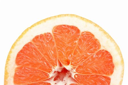 A fresh grapefruit isolated on white background. Shallow depth of field Stock Photo - Budget Royalty-Free & Subscription, Code: 400-05148143