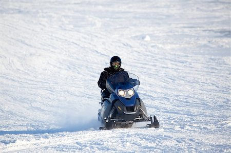 sports scooters - A snowmobile isolated against a winter snow landscape Stock Photo - Budget Royalty-Free & Subscription, Code: 400-05140140