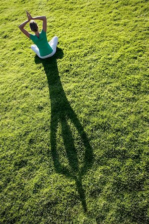 spanishalex (artist) - Woman meditating on green grass with a long afternoon shadow Stock Photo - Budget Royalty-Free & Subscription, Code: 400-05141301