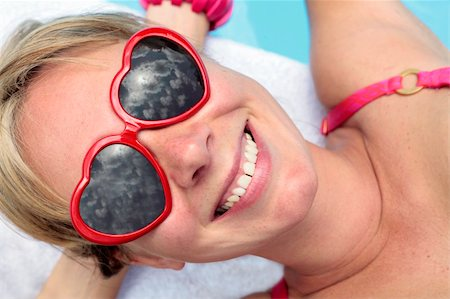 spanishalex (artist) - Woman in heart-shaped sunglasses besides a bright blue swimming pool Stock Photo - Budget Royalty-Free & Subscription, Code: 400-05143871