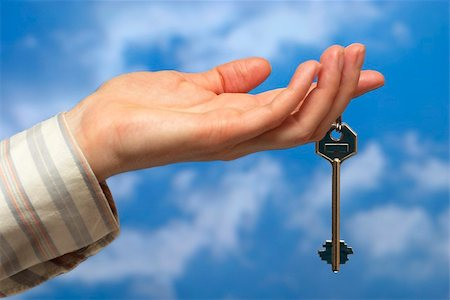 simsearch:400-05936191,k - Hand holding a key over sky and clouds backgound Stock Photo - Budget Royalty-Free & Subscription, Code: 400-05155649