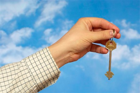 simsearch:400-05936191,k - Hand holding a key over sky and clouds backgound Stock Photo - Budget Royalty-Free & Subscription, Code: 400-05155654