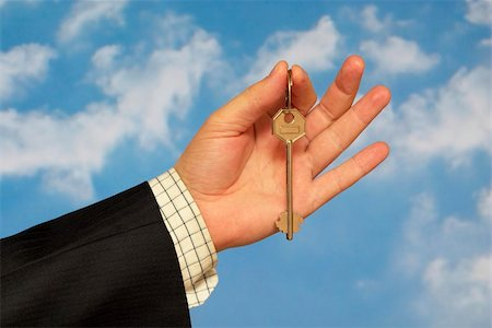 simsearch:400-05936191,k - Hand holding a key over sky and clouds backgound Stock Photo - Budget Royalty-Free & Subscription, Code: 400-05155655