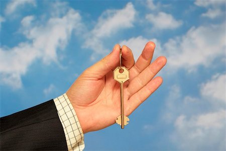 simsearch:400-05936191,k - Hand holding a key over sky and clouds backgound Stock Photo - Budget Royalty-Free & Subscription, Code: 400-05155656