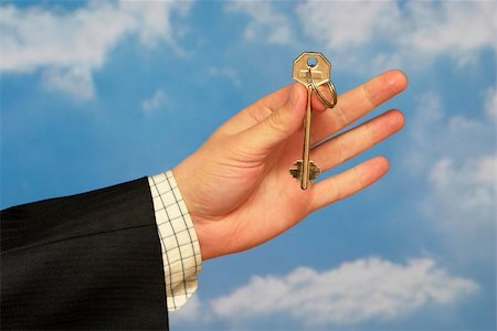 simsearch:400-05936191,k - Hand holding a key over sky and clouds backgound Stock Photo - Budget Royalty-Free & Subscription, Code: 400-05155657