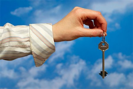 simsearch:400-05936191,k - Hand holding a key over sky and clouds backgound Stock Photo - Budget Royalty-Free & Subscription, Code: 400-05155650