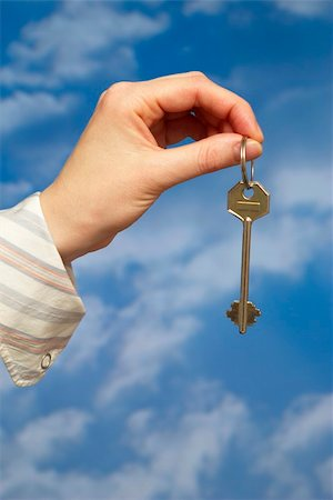 simsearch:400-05936191,k - Hand holding a key over sky and clouds backgound Stock Photo - Budget Royalty-Free & Subscription, Code: 400-05155651