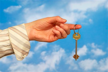 simsearch:400-05936191,k - Hand holding a key over sky and clouds backgound Stock Photo - Budget Royalty-Free & Subscription, Code: 400-05155652
