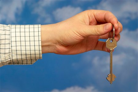 simsearch:400-05936191,k - Hand holding a key over sky and clouds backgound Stock Photo - Budget Royalty-Free & Subscription, Code: 400-05155653