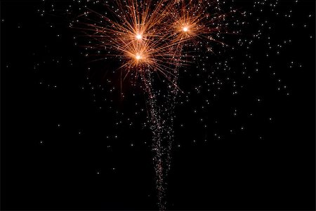 Fireworks exploding in the dark of the evening sky. Stock Photo - Budget Royalty-Free & Subscription, Code: 400-05150157