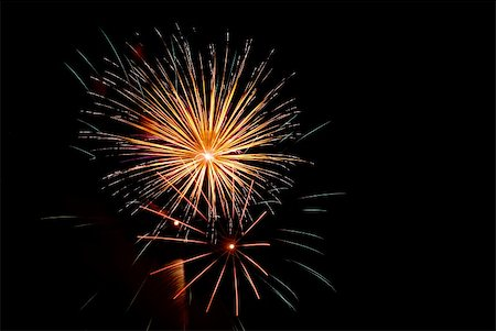 Fireworks exploding in the dark of the evening sky. Stock Photo - Budget Royalty-Free & Subscription, Code: 400-05150160