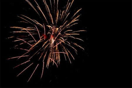 Fireworks exploding in the dark of the evening sky. Stock Photo - Budget Royalty-Free & Subscription, Code: 400-05150163