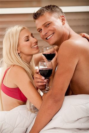 Couple sharing wine in bed Stock Photo - Budget Royalty-Free & Subscription, Code: 400-05152474