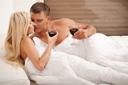 Couple drinking on the bed in bedroom Stock Photo - Budget Royalty-Free & Subscription, Code: 400-05152488