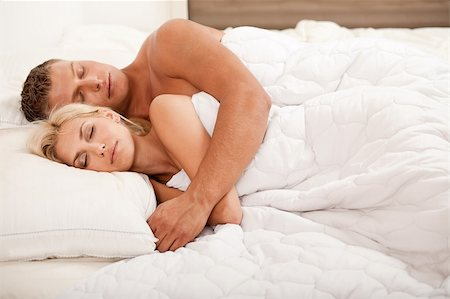 Young couple sleeping and hugging on bed Stock Photo - Budget Royalty-Free & Subscription, Code: 400-05152483
