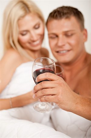 Young couple toasting champagne in bed Stock Photo - Budget Royalty-Free & Subscription, Code: 400-05152491