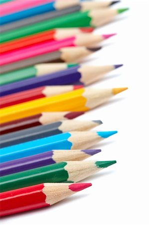 Assortment of coloured pencils with shadow on white background. Shallow depth of field Stock Photo - Budget Royalty-Free & Subscription, Code: 400-05153786