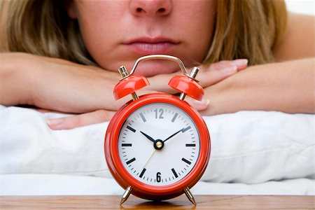 spanishalex (artist) - Woman with red alarm clock representing lateness or a deadline Stock Photo - Budget Royalty-Free & Subscription, Code: 400-05168966