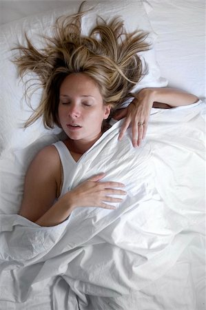 spanishalex (artist) - Woman asleep in bed wrapped in white sheets Stock Photo - Budget Royalty-Free & Subscription, Code: 400-05168963