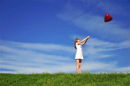 flying heart girl - girl with a red balloon in the form of heart on the background of the sky Stock Photo - Budget Royalty-Free & Subscription, Code: 400-05160977