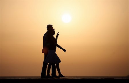 silhouette of jung family Stock Photo - Budget Royalty-Free & Subscription, Code: 400-05176134