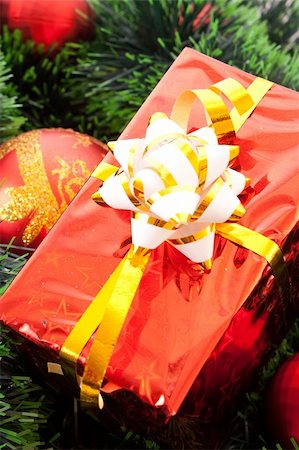 silver box - Red Christmas balls and presents  among green new year tree Stock Photo - Budget Royalty-Free & Subscription, Code: 400-05177586