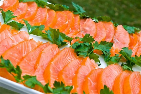 smoked color lines - Sliced smoked salmon fillet decorated with green parsley on white plate Stock Photo - Budget Royalty-Free & Subscription, Code: 400-05178194