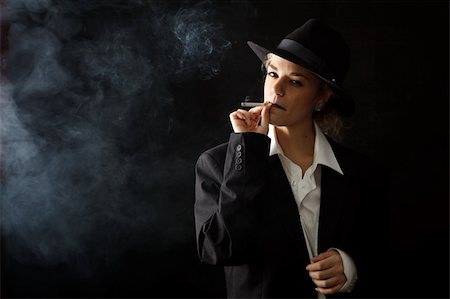 beautiful girl in a man's suit, smoke on black background Stock Photo - Budget Royalty-Free & Subscription, Code: 400-05185695