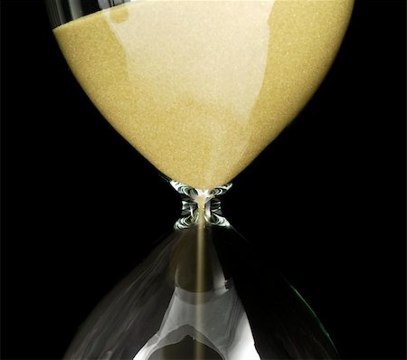 sand clock - Hourglass detail  isolated on a black background Stock Photo - Budget Royalty-Free & Subscription, Code: 400-05187445