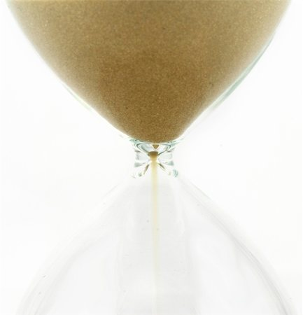 sand clock - Hourglass detail  isolated on a white background Stock Photo - Budget Royalty-Free & Subscription, Code: 400-05187446