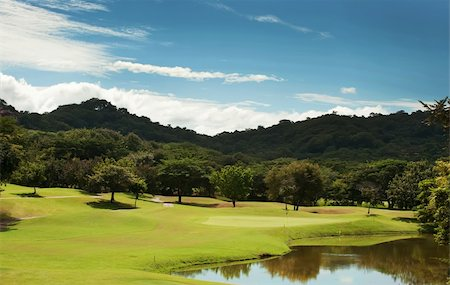 Image of a beautiful golf course fairway at a tropical resort Stock Photo - Budget Royalty-Free & Subscription, Code: 400-05187616