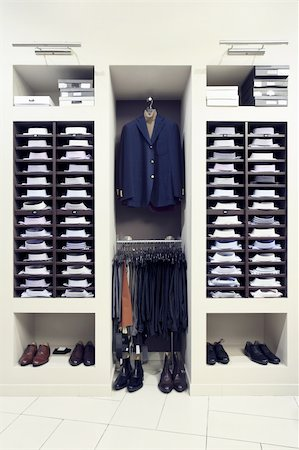 Stylish clothes in a modern shop interior Stock Photo - Budget Royalty-Free & Subscription, Code: 400-05180001
