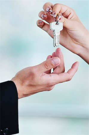 simsearch:400-05936191,k - man and woman hand closeup with home keys representing buying and selling new apartment and real estate concept Stock Photo - Budget Royalty-Free & Subscription, Code: 400-05181079